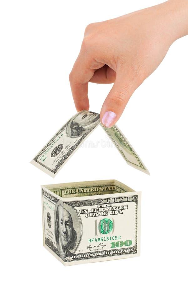 Hand- und Geldhaus stockfoto