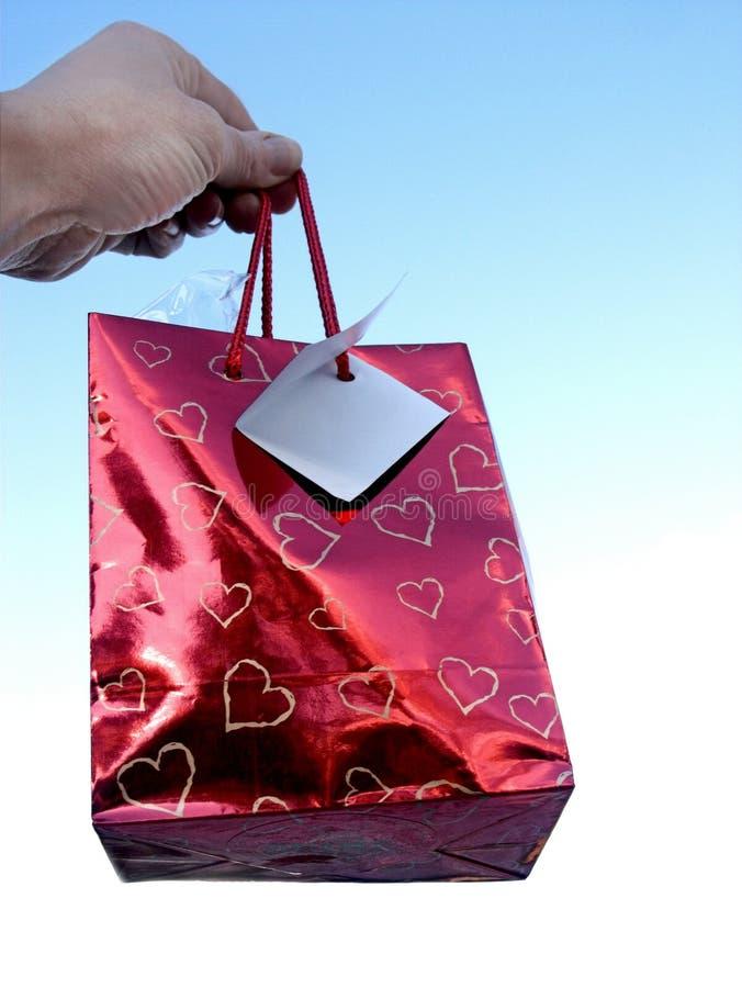 Hand und Geschenk lizenzfreie stockfotografie