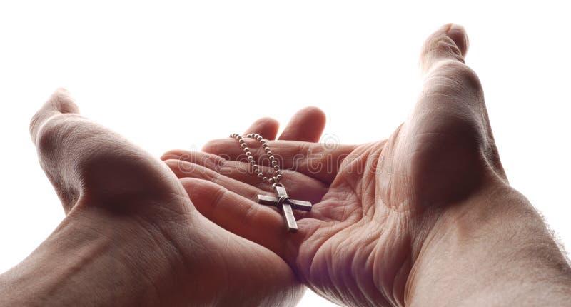 Hand und Kreuz stockfoto