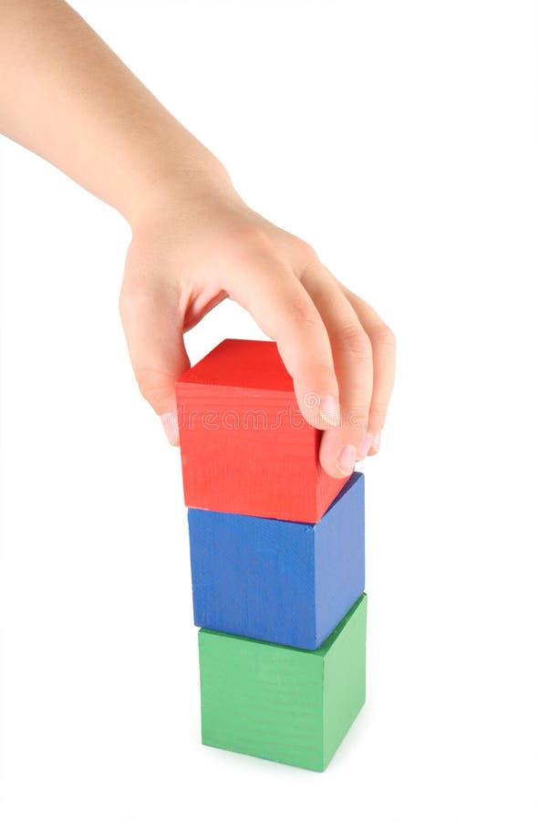 Hand- und Spielzeugwürfel der Kinder lizenzfreie stockfotografie