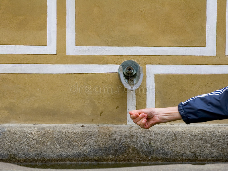 Hand Under Waterwater Spout In Europe Royalty Free Stock Photography