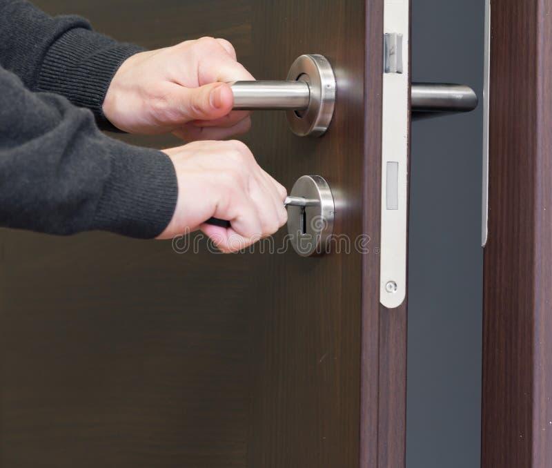 unlock door key  stock photo  unlock key on wooden door