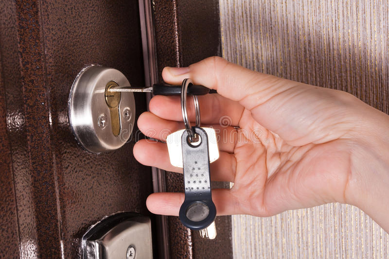 Download Hand Unlocking Front Door Lock Of House Closeup Stock Image - Image of enter & Hand Unlocking Front Door Lock Of House Closeup Stock Image - Image ...