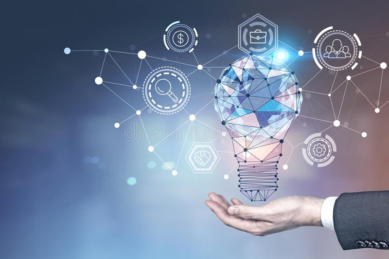 Man hand, glowing light bulb, network interface royalty free stock photo