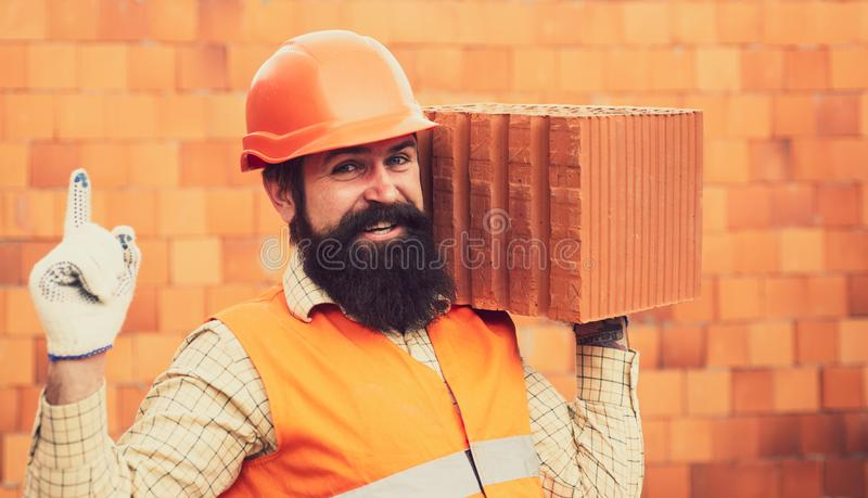 Hand up with finger point of Builder repairman worker. Builder dressed in protective vests and helmets. Worker at the royalty free stock photos