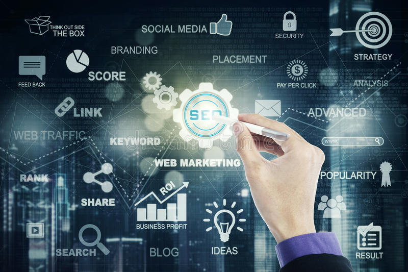 Hand uses stylus pen and SEO icon. Male entrepreneur hand using a stylus pen to press a SEO button on the virtual screen. SEO concept stock images