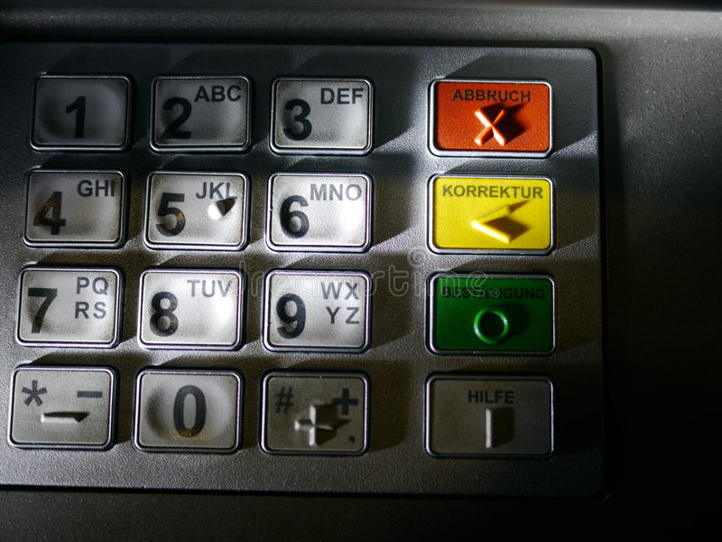 Hand Using ATM Keyboard. Finger using automatic teller keypad to enter pin number royalty free stock photography