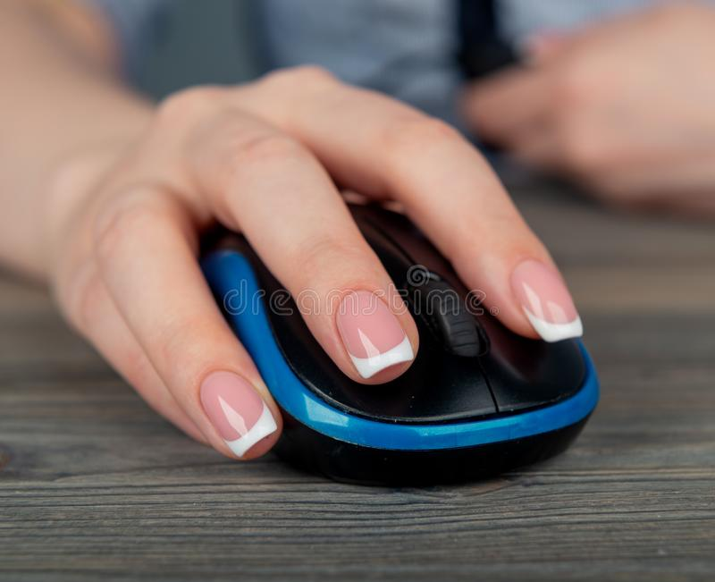 Hand using computer mouse royalty free stock photo