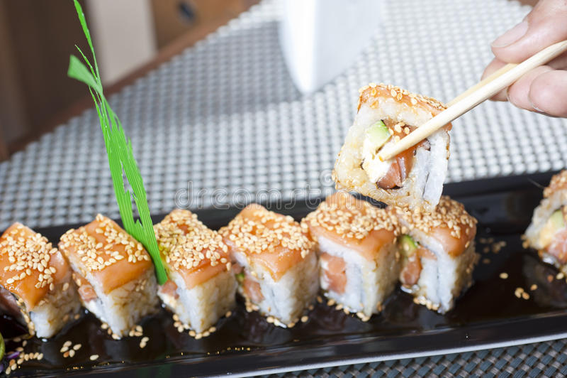 Hand Using Chopsticks With Sushi Royalty Free Stock Image