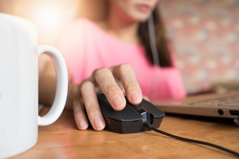 Hand using Computer mouse for online business work royalty free stock image