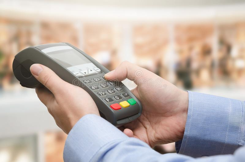 Hand using credit card payment machine stock image
