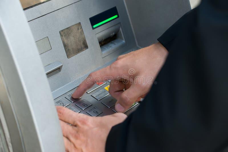 Hand Using Keypad Atm Machine stock image