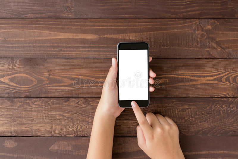 Hand using phone blank screen on top view. Angle royalty free stock images