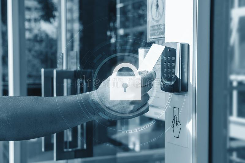 Hand using security key card scanning open the door to entering private building with lock icon technology. Home and building secu royalty free stock photography