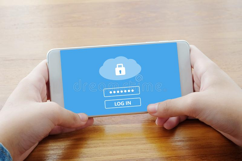 Hand using smart phone with cloud data storage password login on. Screen, cyber security concept royalty free stock images