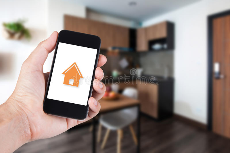 Hand using smartphone by app smart home on mobile royalty free stock images