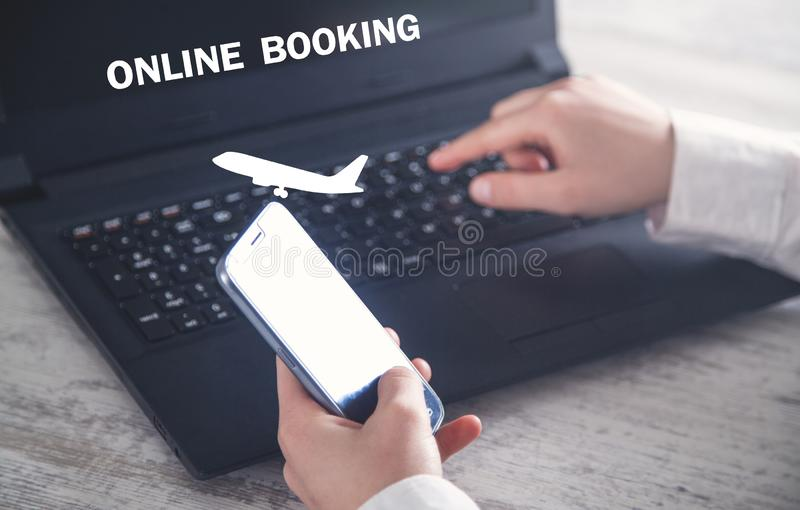 Hand using smartphone. Buying flight ticket. Online Booking royalty free stock photo
