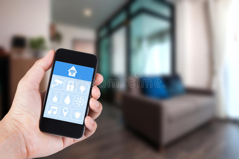 Hand using smartphone to smart home app on mobile. royalty free stock photo
