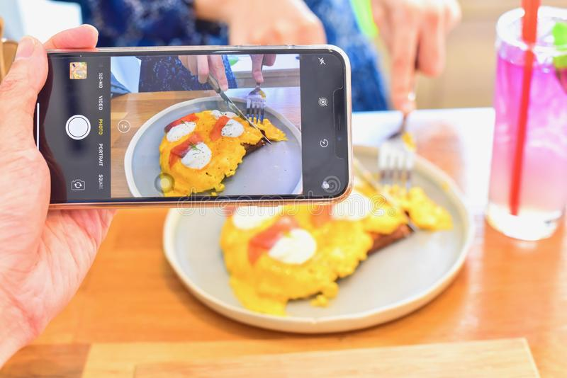 Hand Using Smartphone to Take Food Photography stock photos