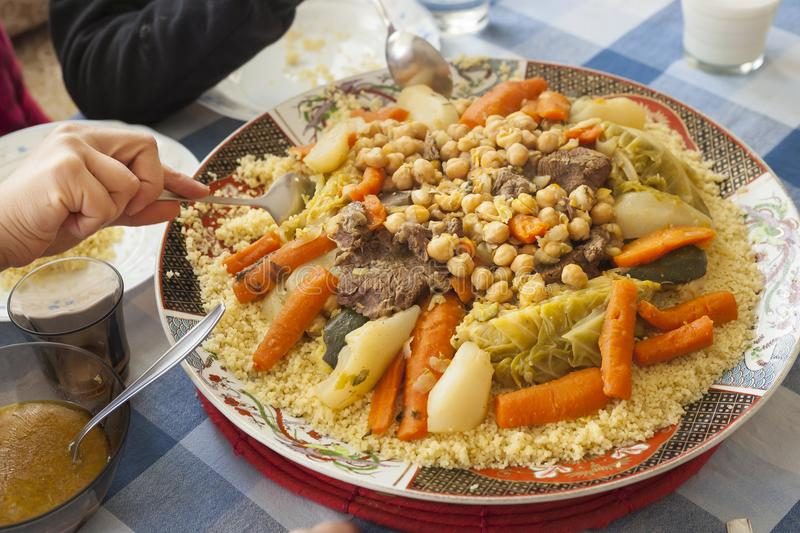 Couscous plate on a family table stock image