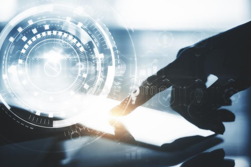 Hand using tablet with hologram royalty free stock photo
