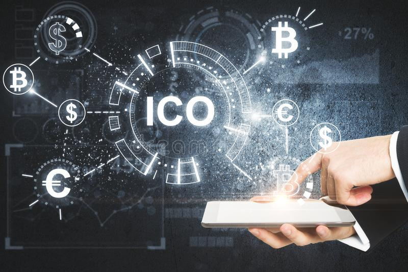 Hand using tablet with ico hologram stock images