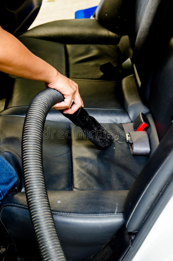 hand vacuum cleaning dirt on a back car seats stock photo image 36848094. Black Bedroom Furniture Sets. Home Design Ideas