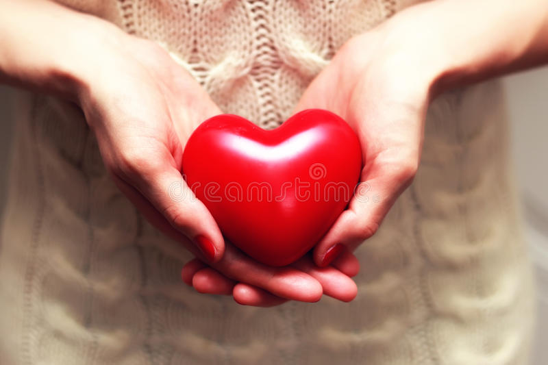 Hand valentine heart woolen royalty free stock photography