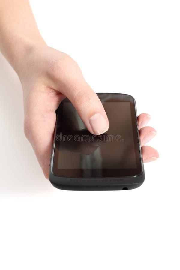 De hand van de vrouw wat betreft het aanrakingsscherm van een mobiele telefoon royalty-vrije stock foto's