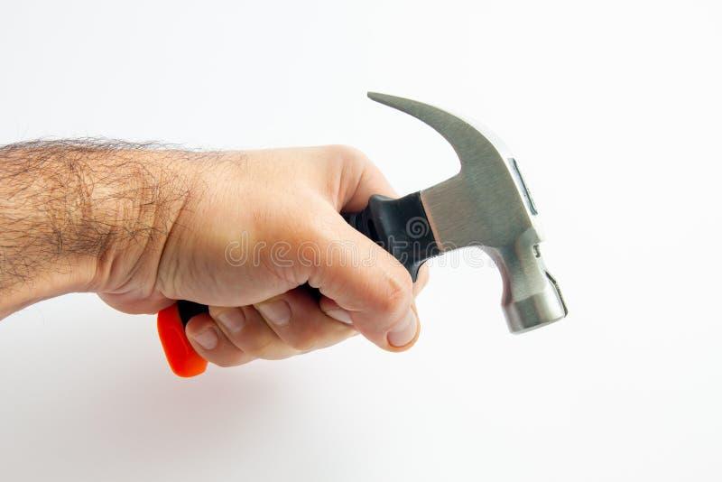 Hand van een arbeider met een hamer royalty-vrije stock fotografie