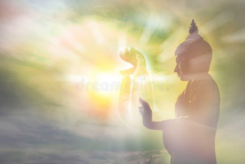 Hand van het standbeeld van Boedha, licht van wijsheid en concentratieconcept stock fotografie