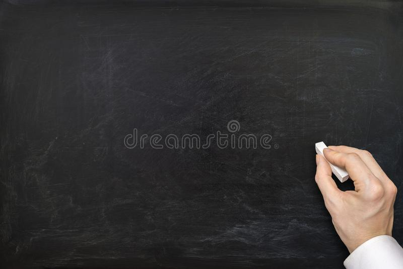 Hand van leraar en leeg bord royalty-vrije stock afbeelding