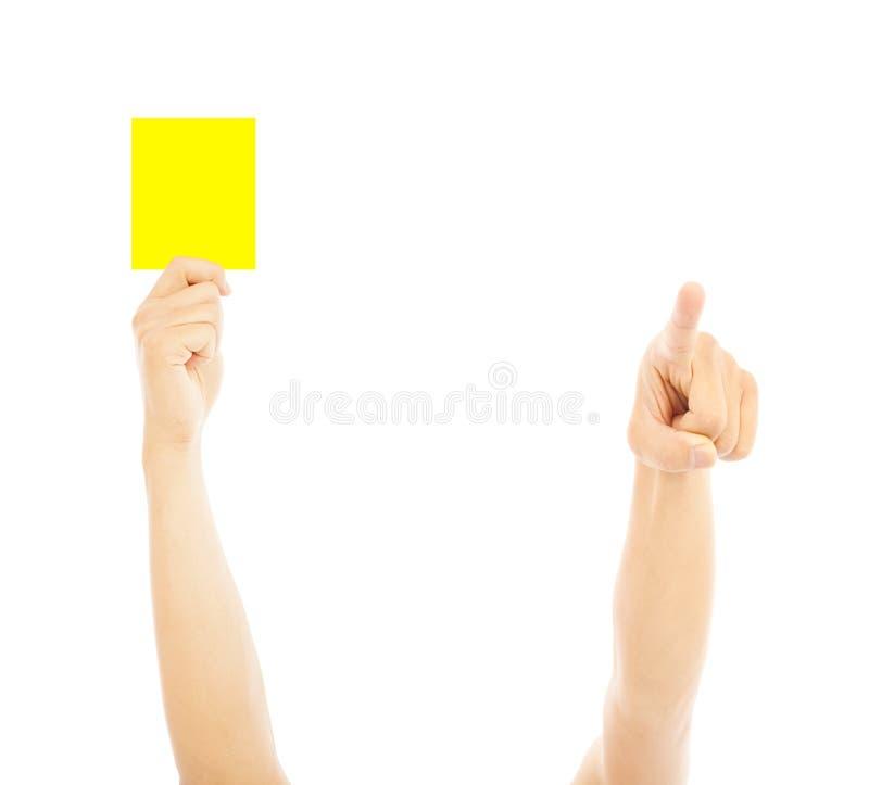 Hand van scheidsrechter met gele kaart om te waarschuwen stock foto's