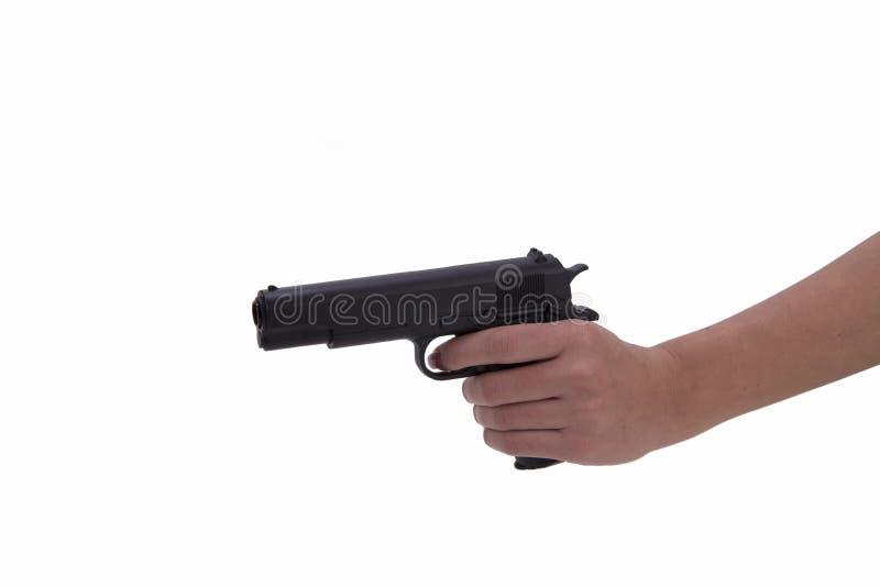 Hand van vrouw met kanon stock afbeelding
