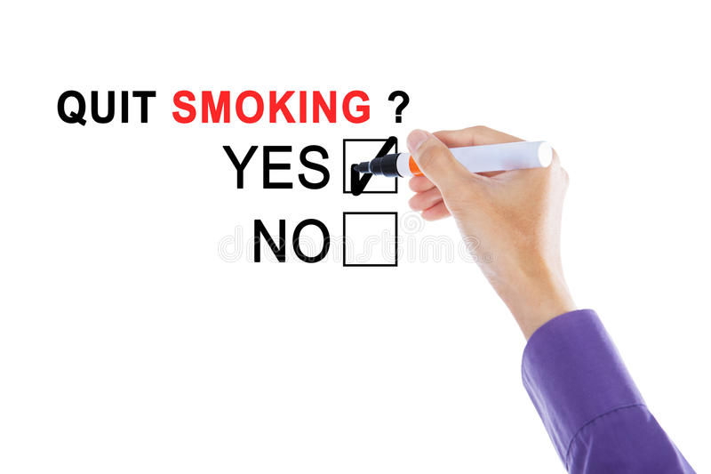 Hand van zakenman met tekst van het opgehouden met roken stock afbeelding