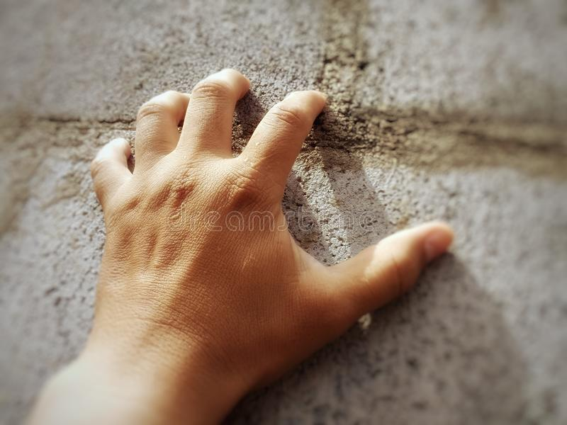Hand on the wall. Fighter, hope, difficulty, strength, will, effort, always forward royalty free stock images