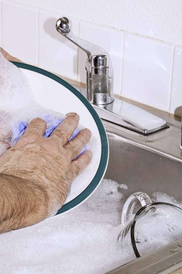 Hand washing the dishes royalty free stock image