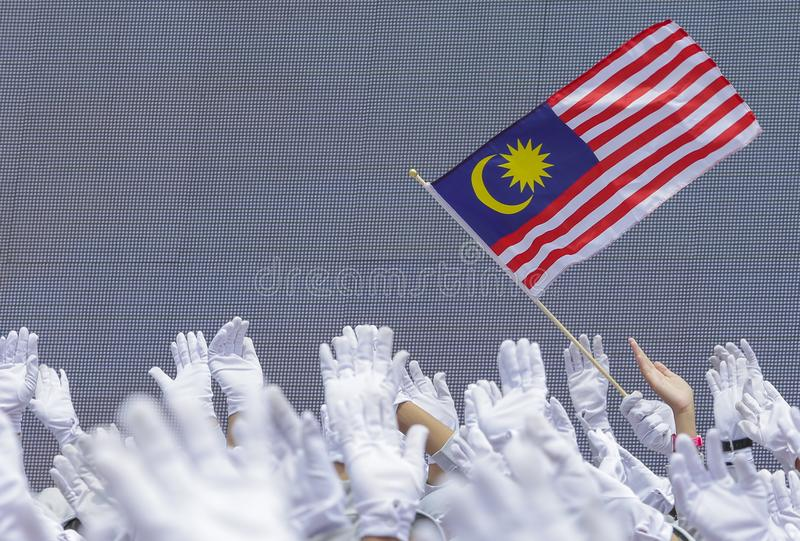 Hand waving Malaysia flag also known as Jalur Gemilang. People fly the flag in conjunction with the Independence Day celebration or Merdeka Day on 31 August stock photography