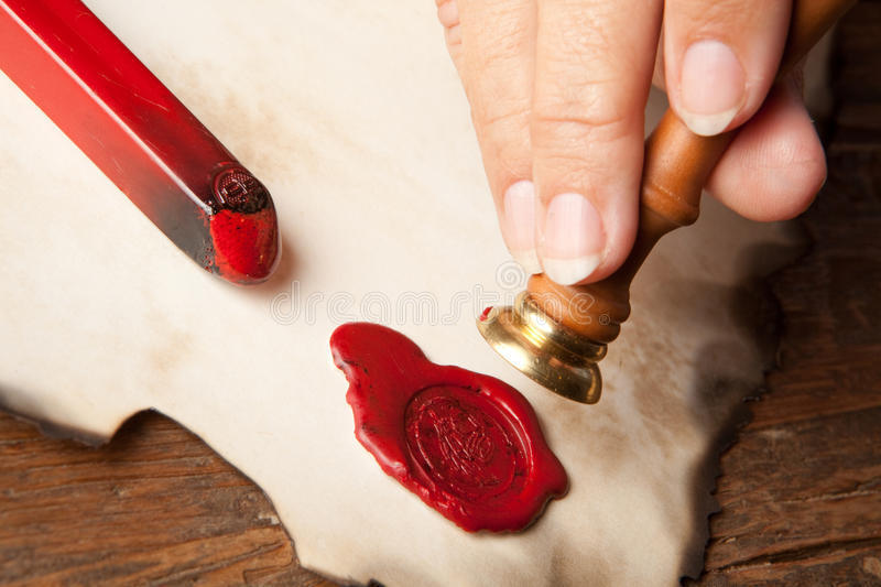Hand with wax seal royalty free stock images
