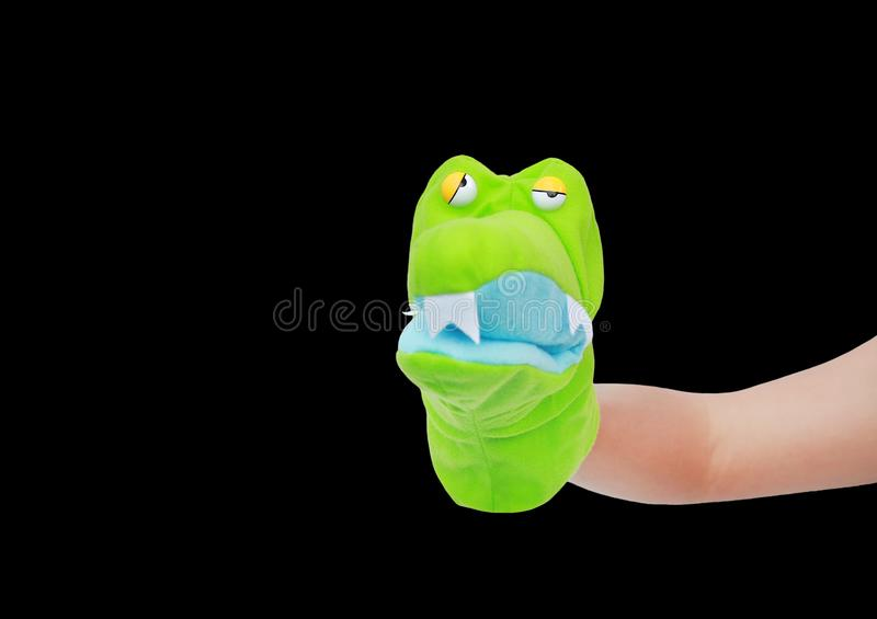 Hand wearing Crocodile puppets isolated on black background, Crocodile head stock images