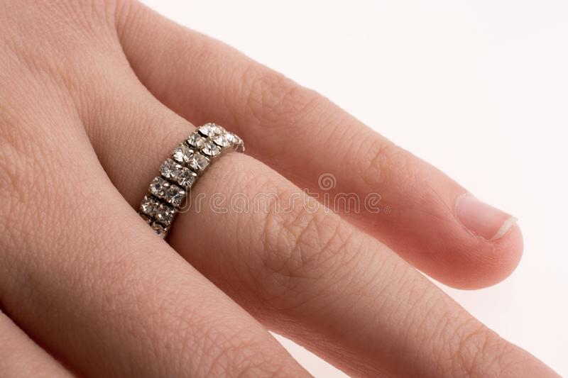 Hand wearing a ring. On a white background stock image
