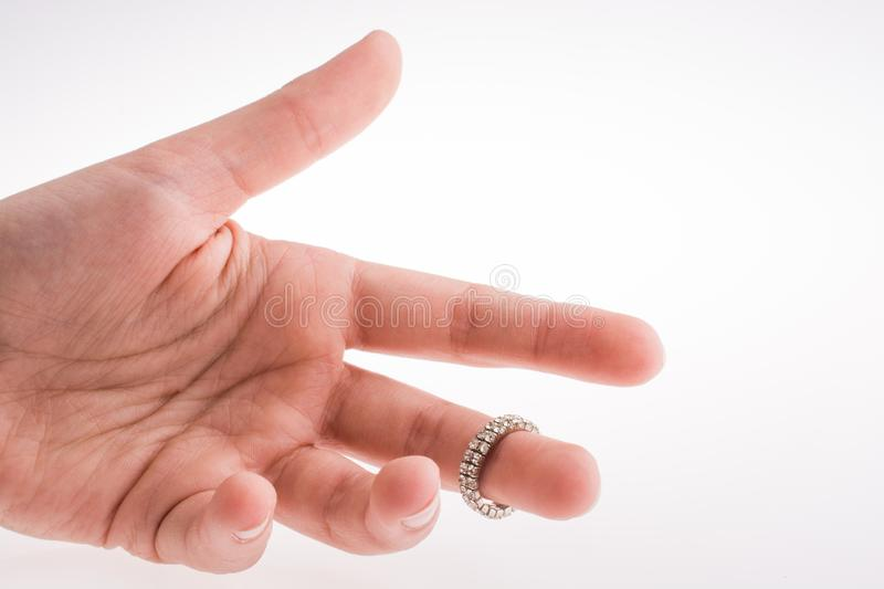 Hand wearing a ring. On a white background royalty free stock image