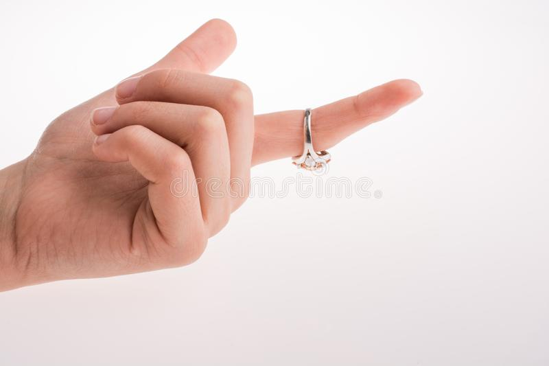 Hand wearing a ring. On a white background stock photo