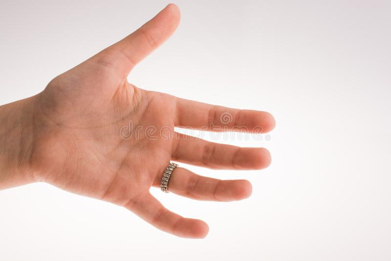 Hand wearing a ring. On a white background stock photos