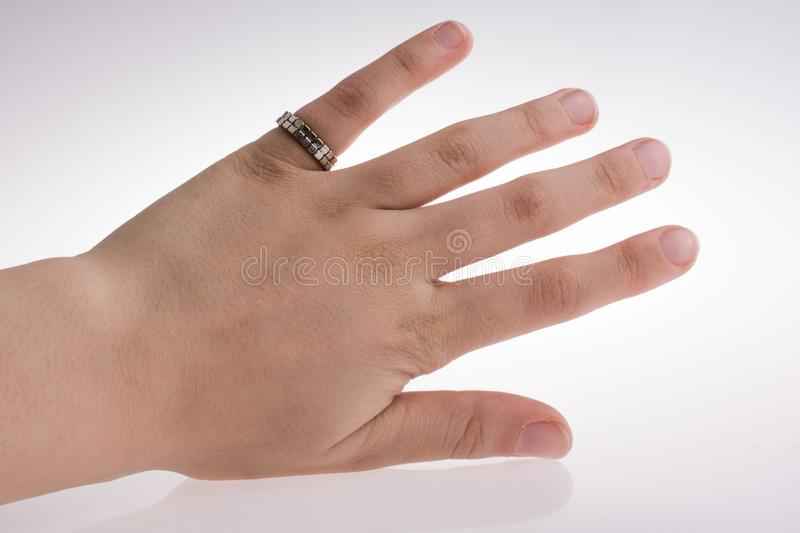 Hand wearing a ring. On a white background royalty free stock images