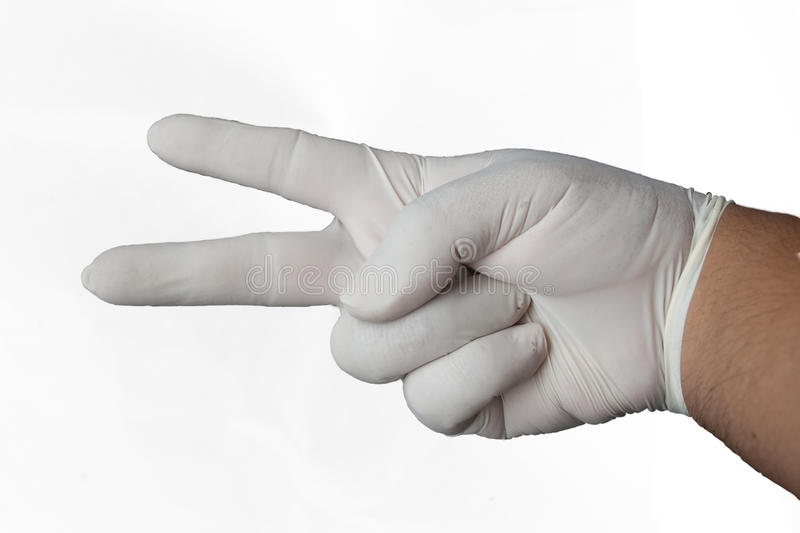 Hand wearing rubber glove stock photography