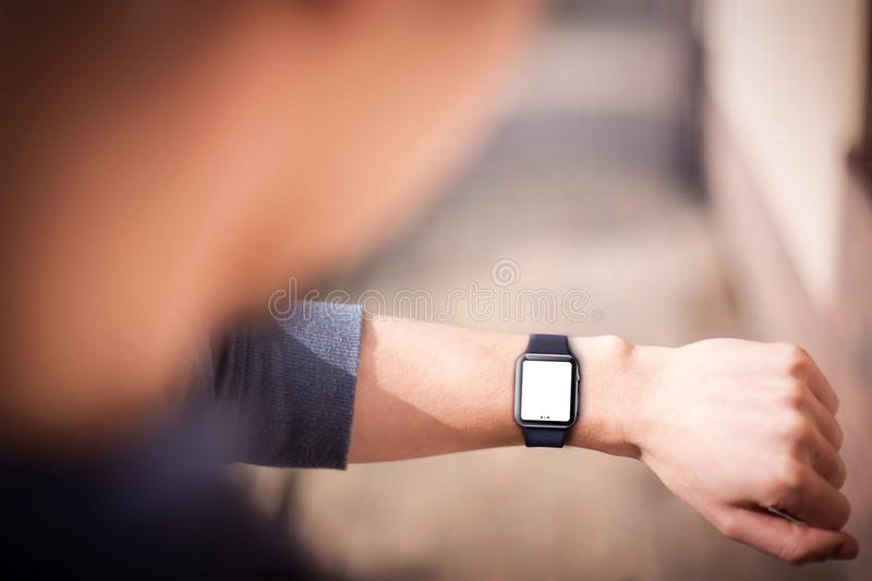 Hand wearing smartwatch. Hand wearing elegant smartwatch with blank screen stock photography
