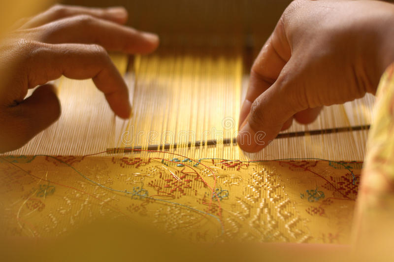Hand Weaving A Songket stock images