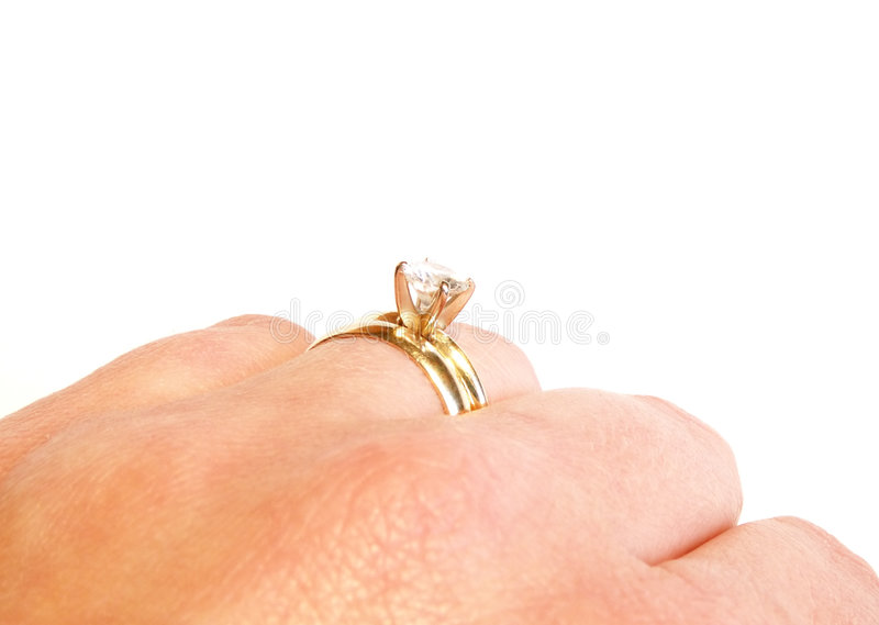 Hand with wedding ring stock photos