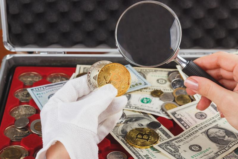 Hand in the glove with a gold and silver coins. Hand in the white glove with gold and silver coins, soft focus background stock images